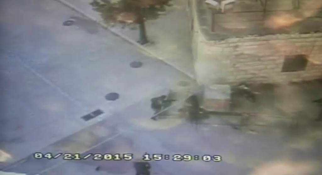Footage of what police said was a Palestinian man stabbing a Border Police officer in Hebron on Saturday, April 25, 2015. (screen capture: Israel Police video)