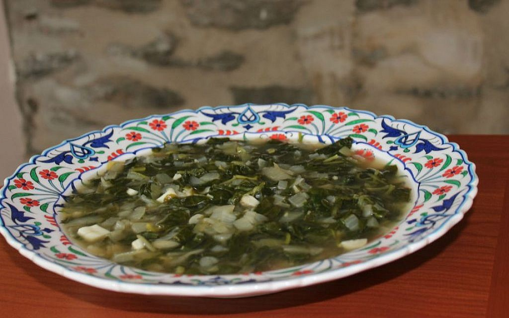 Veteran Jerusalemite families celebrate independence with mallow soup. (Ronit Treatman/The Times of Israel)