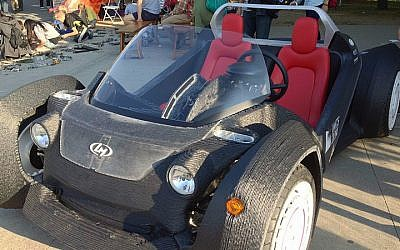 The Strati, an electronic car produced entirely by 3D printing. (photo credit: CC BY 3.0/z22/Wikimedia Commons)
