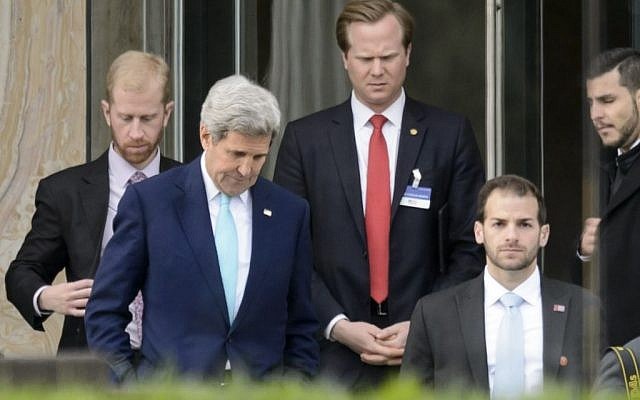 US Secretary of State John Kerry, front left, walks during a break outside the Beau Rivage Palace Hotel as the Iran nuclear talks continue, in Lausanne, Switzerland, Wednesday, April 1, 2015. (photo credit: AP Photo/Keystone,Laurent Gillieron)