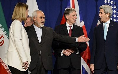 From left: EU High Representative for Foreign Affairs and Security Policy Federica Mogherini; Iranian Foreign Minister Mohammad Javad Zarif; British Foreign Secretary Philip Hammond; and US Secretary of State John Kerry line up for a press announcement at the nuclear talks in Lausanne, Switzerland, April 2, 2015. (photo credit: AP/Keystone, Jean-Christophe Bott)