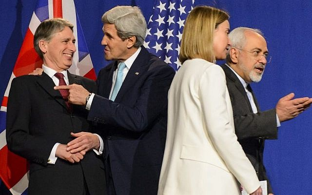 From left, British Foreign Secretary Philip Hammond, US Secretary of State John Kerry, EU High Representative for Foreign Affairs and Security Policy Federica Mogherini, and Iranian Foreign Minister Mohammad Javad Zarif in Lausanne, Switzerland, Thursday, April 2, 2015. (Photo credit: AP/Keystone, Jean-Christophe Bott)