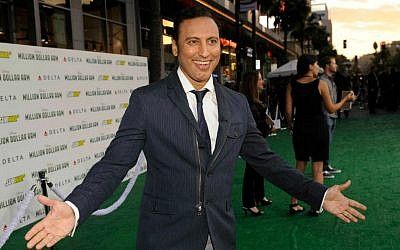 Aasif Mandvi arrives at the world premiere of 'Million Dollar Arm' in Los Angeles, California, on May 6, 2014. (photo credit: Chris Pizzello/Invision/AP, File)