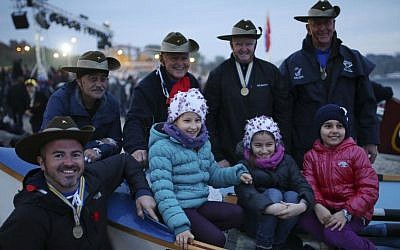 "Australians pose for pictures with Turkish children on a boat, named ""Gallipoli,"" in Hamza Bay, at the Gallipoli peninsula, Turkey, early Saturday, April 25, 2015. (photo credit: AP/Emrah Gurel)"