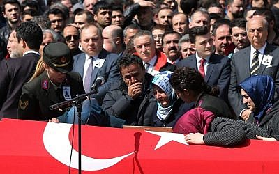 Family members, colleagues and politicians attend the funeral ceremony for Turkish prosecutor Mehmet Selim Kiraz, as many other people gather at the Eyup Mosque in Istanbul, Turkey, Wednesday, April 1, 2015. (photo: AP/Emrah Gurel)