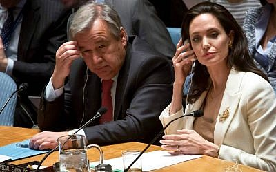 UN Special Envoy for Refugees and actress Angelina Jolie, right, and then-UN High Commissioner for Refugees António Guterres, left, brief the UN Security Council on Syria's refugee crisis, Friday, April 24, 2015. (AP Photo/Bebeto Matthews)