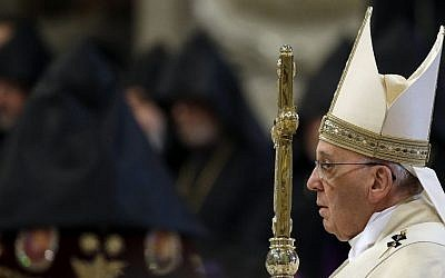 Pope Francis arrives to celebrates an Armenian-Rite Mass on the occasion of the commemoration of the 100th anniversary of the Armenian Genocide, in St. Peter's Basilica, at the Vatican Sunday, April 12, 2015. (photo credit: AP/Gregorio Borgia)