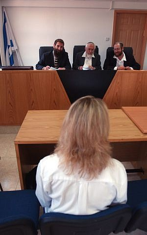 Illustrative photo of a woman converting to Judaism at a Jerusalem rabbinic court in 2003. (Flash 90)