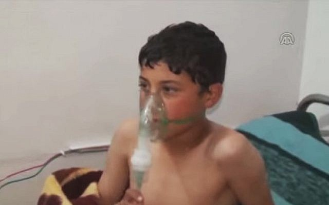 A child victim of a suspected chlorine attack in Idlib, Syria, in March 2015 (screen capture: YouTube)