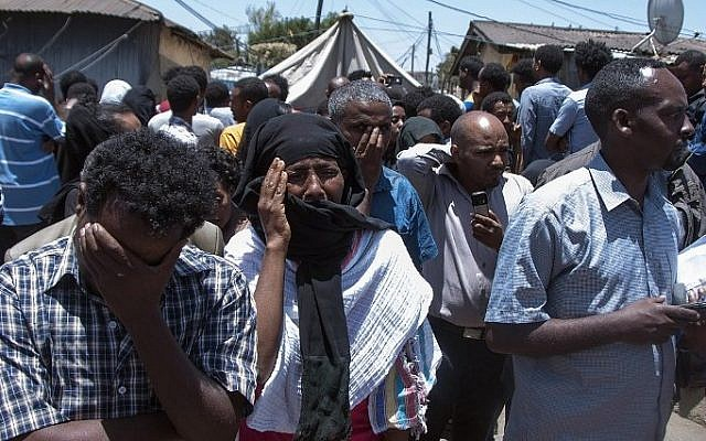 Ethiopians mourn for relatives and friends killed by the Islamic State group, as they gather in streets of the Ethiopian capital, Addis Ababa on April 21, 2015. (Photo credit: AFP/ELIAS ASMARE)
