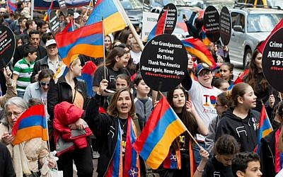 Pro-Armenian activists march in midtown Manhattan in New York on Sunday, April 26, 2015, to mark the centennial of the killings of 1.5 million Armenians under the Ottoman Empire — today's Turkey. The activists are demanding that the US government recognize the killings, which took place before and during World War I, as genocide. (Photo credit: AP/Mark Lennihan)