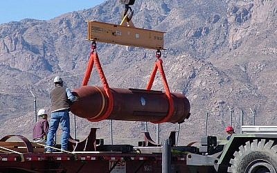 A Massive Ordnance Penetrator is off-loaded at a US defense facility (Photo credit: US Government/Public Domain)