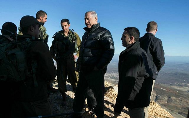 Prime Minister Benjamin Netanyahu during a February  4, 2015, visit to an army position on Mount Hermon (photo credit: AP Photo/ Baz Ratner, pool)