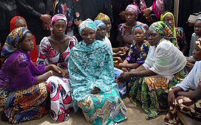 A file picture taken on May 5, 2014 shows Chibok school girls who escaped from the Boko Haram Islamists gathering to receive information from officials (photo credit: AFP/STR)