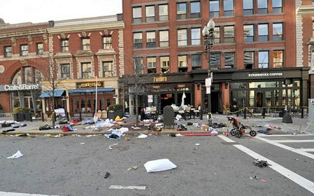 This April 15, 2013 forensics photograph made by the FBI; provided Thursday, April 23, 2015, by the US Attorney's office; and presented in federal court as evidence during the penalty phase of convicted Boston Marathon bomber Dzhokhar Tsarnaev's trial, shows the scene where the second bomb exploded on Boylston Street near the marathon finish line in Boston. (Photo credit: US Attorney's Office via AP)