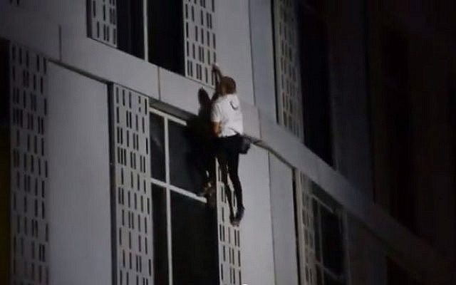 Alain Robert, 52, scales the 75-story Cayan Tower in Dubai on Sunday, April 13, 2015 (screen capture: YouTube)