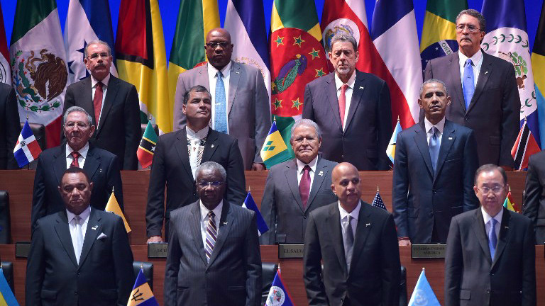 Cuba's President Raul Castro (L, middle row) and US President Barack Obama (R, middle row) are pictured with other leaders during the opening ceremony of the Summit of the Americas at the ATLAPA Convention Center in Panama City on April 10, 2015 (photo credit: AFP/MANDEL NGAN)