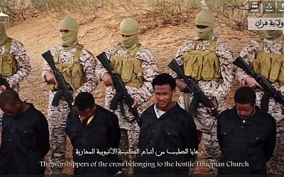 Islamic State fighters prepare to execute Coptic Christians in Libya, in a video released by the terror group's media arm, on Sunday, April 19 2015. (Screen capture: Dailymotion)