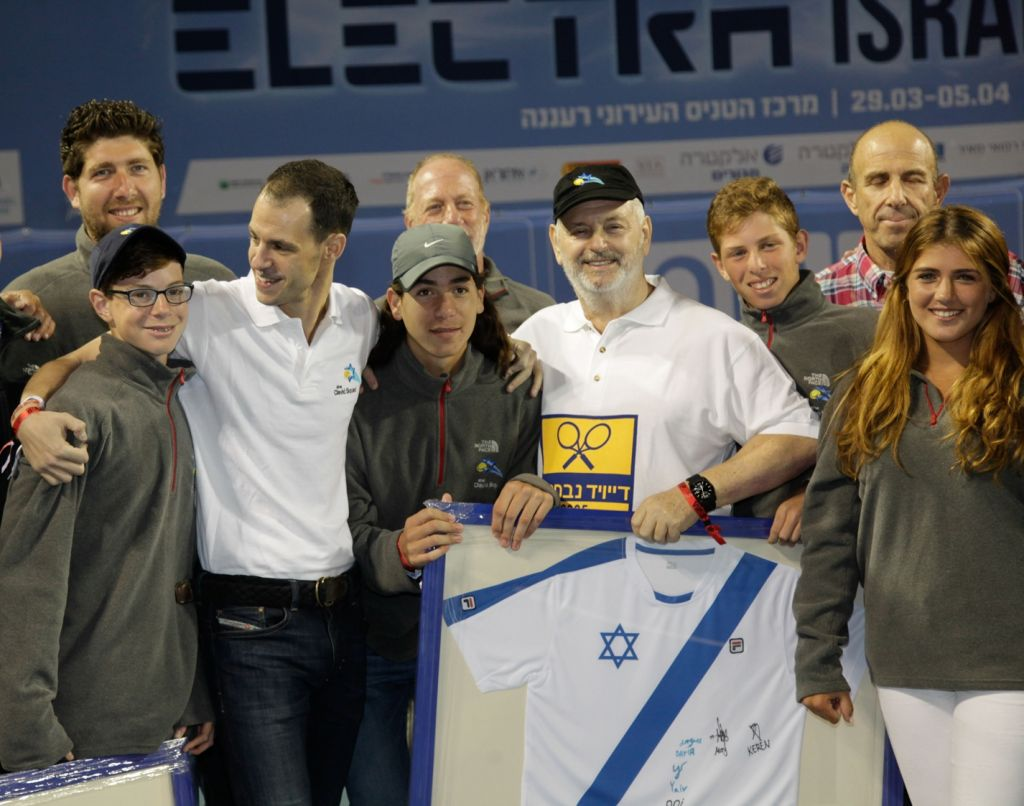 David Coffer, in black hat, at ceremony in Raanana honoring him and son Adam, third from left, for 10 years of service to Israeli tennis, April 2015. (Courtesy of the David Squad/JTA)