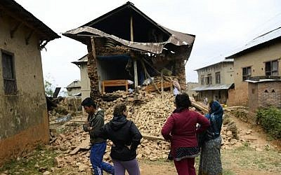 Israeli volunteers and local Nepali residents in the village of Manegau in the Kabri district, where Tevel B'Tzedek is working, which was heavily damaged in Saturday's earthquake. (photo courtesy Tevel B'Tzedek)
