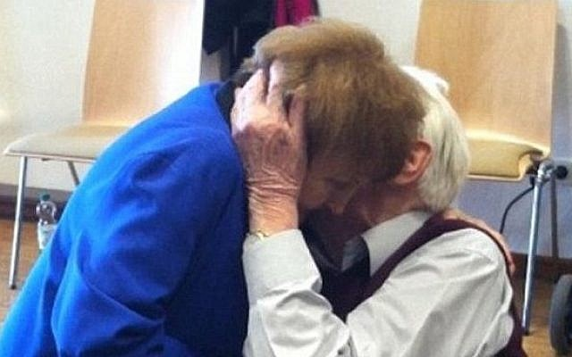 Auschwitz survivor Eva Kor and former SS guard Oskar Groening embrace during the latter's trial on 300,000 counts of accessory to murder. (Photo credit: screenshot/Daily Mail)