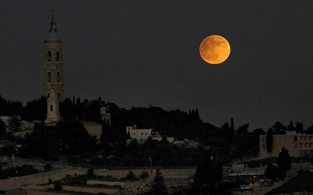 View of a full moon shining on the Mount of Olives in Jerusalem on November 27, 2012. (Louis Fisher/FLASH90)
