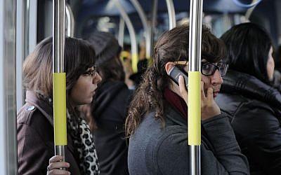 Young women ride the light rail in Jerusalem, December 10, 2012 (photo credit: Louis Fischer/Flash90)