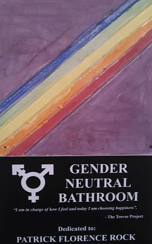 A plaque identifying the new gender-neutral bathroom at Jack M. Barrack Hebrew Academy near Philadelphia. (JTA)