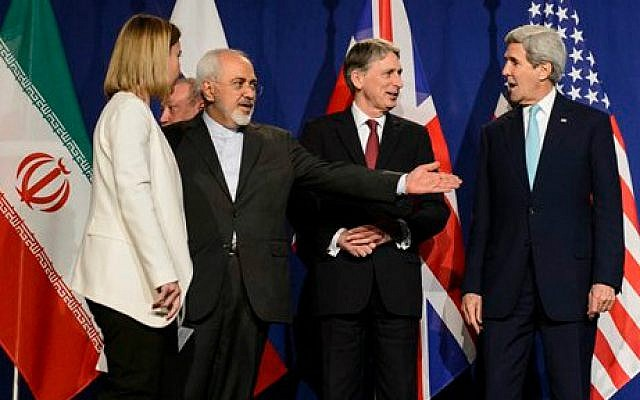 In this file photo taken Thursday, April 2, 2015, from left, EU High Representative for Foreign Affairs and Security Policy, Federica Mogherini, Iranian Foreign Minister, Mohammad Javad Zarif, British Foreign Secretary, Philip Hammond, and US Secretary of State, John Kerry, line up for a press announcement after a new round of Nuclear Iran Talks in the Learning Center at the Swiss federal Institute of Technology (EPFL) in Lausanne, Switzerland (photo credit: AP/Keystone, Jean-Christophe Bott, File)