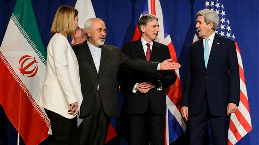In this file photo taken Thursday, April 2, 2015, from left, EU High Representative for Foreign Affairs and Security Policy, Federica Mogherini, Iranian Foreign Minister, Mohammad Javad Zarif, British Foreign Secretary, Philip Hammond, and US.Secretary of State, John Kerry, line up for a press announcement after a new round of Nuclear Iran Talks in the Learning Center at the Swiss federal Institute of Technology (EPFL) in Lausanne, Switzerland (photo credit: AP/Keystone, Jean-Christophe Bott, File)
