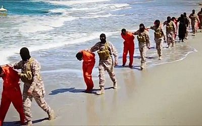 This undated image made from a video released by Islamic State militants, Sunday, April 19, 2015, appears to show the killing of a group of captured Ethiopian Christians in Libya. (Militant video via AP)