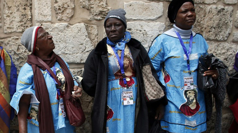 Catholic worshipers from Ivory Coast attend the ceremony at the Holy Sepuchre during the Good Friday procession along the Via Dolorosa (Way of Suffering) on April 3, 2015 in Jerusalem's Old City (screen capture: AFP/Thomas Coex)
