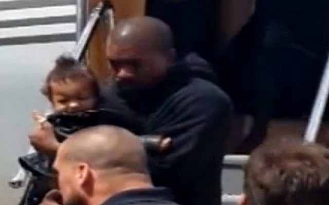 Kanye West, baby North West land in Israel on April 13, 2015 (screen capture: Channel 2)