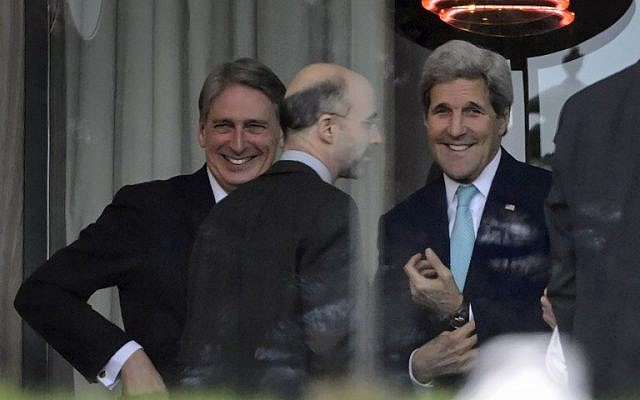 From left: British Foreign Secretary Philip Hammond, Senior Director at the National Security Council Robert Malley and US Secretary of State John Kerry stand on the terrace of the Beau-Rivage Palace hotel while taking a break during an extended round of talks on April 1, 2015 in Lausanne (photo credit: AFP/ FABRICE COFFRINI)