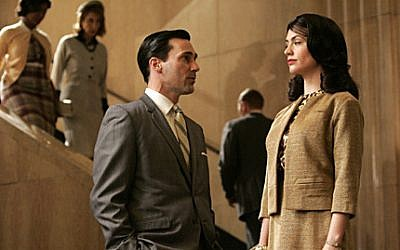 Jon Hamm as Don Draper and Maggie Siff as Rachel Menken in AMC's Mad Men. (photo credit: Doug Hyun/AMC)