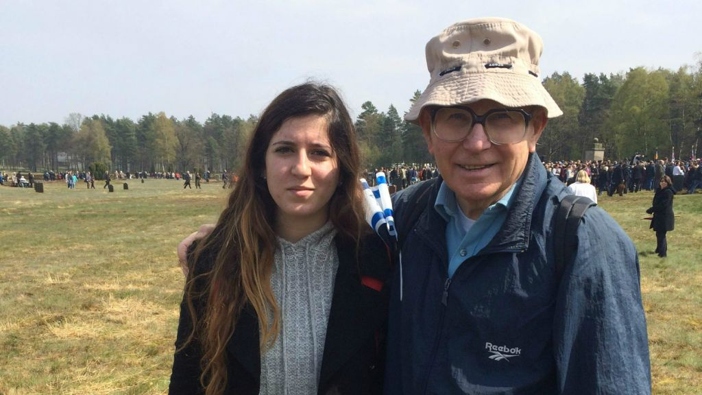 Shaul Ladany, a survivor of the Bergen-Belsen concentration camp, attends the memorial ceremony with his granddaughter Shaked (Photo credit: Renee Ghert-Zand)