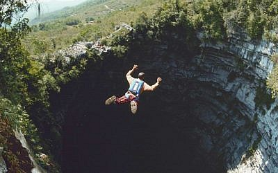 Omer Mei-Dan jumps into the Cave of Swallows, a 1,200-foot-deep site in Mexico. (Courtesy Omer Mei-Dan/JTA)