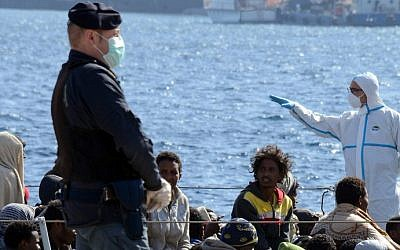 Migrants arrive in the port of Messina after a rescue operation at see on April 18, 2015 in Sicily. A surge of migrants pouring into Europe from across the Mediterranean won't end before chaos in Libya is controlled, Italy's prime minister said yesterday, as the Vatican condemned a deadly clash between Muslim and Christian refugees on one boat. (photo credit: AFP/Giovanni Isolino)