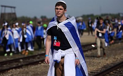 Jewish youth participating in the annual March of the Living commemoration at the Auschwitz-Birkenau concentration camp in Poland, April 24, 2014. (wjarek/Shutterstock)