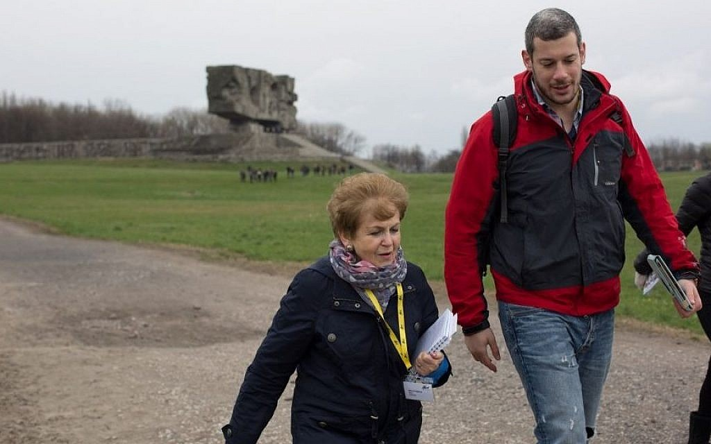 Mala Tribich with UK March of the Living volunteer Johnny Bunt, in Majdanek. (Photo credit: Sam Churchill Photography)