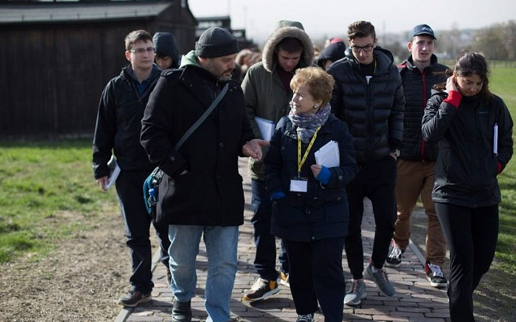 Belsen survivor Mala Tribich, 85, right, with UK delegates in Birkenau. (Photo credit: Sam Churchill Photography)