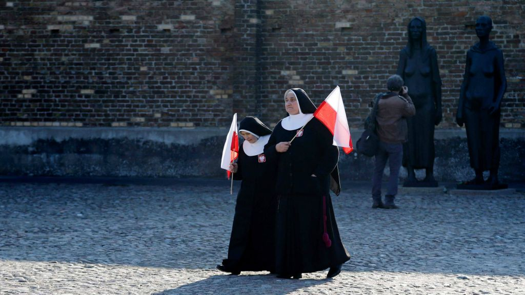 Polish nuns arrive at the former Nazi concentration camp Ravensbrueck in Fuerstenberg, northeastern Germany, Sunday, April 19, 2015 for ceremonies commemorating the 70th anniversary of the liberation of the camp by the Red Army on April 30, 1945. (photo credit: AP Photo/Ferdinand Ostrop)