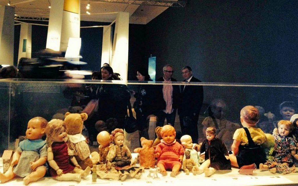 A vitrine of dolls, teddy bears and toys that belonged to survivors and children who didn't survive the Holocaust, at Yad Vashem's new exhibit, 'Stars Without A Heaven' (photo credit: Jessica Steinberg/Times of Israel)