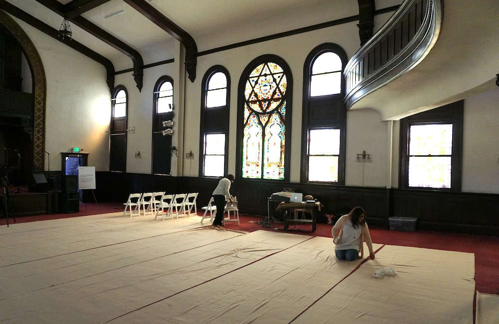 Members of the Women's Mosque of America preparing the sanctuary at Pico Union Project for an afternoon prayer service. (Anthony Weiss/JTA)