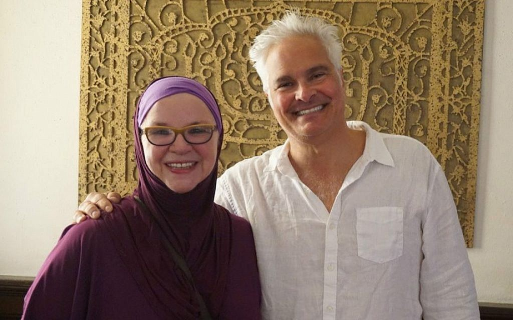 Craig Taubman with Normalika Chishti, a member of the Women's Mosque of America. (Anthony Weiss/JTA)