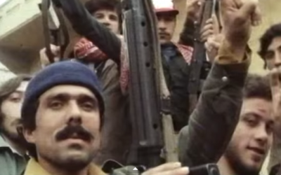 PLO fighters gesture towards a camera during the early years of the Lebanese Civil War. (screen capture: YouTube)
