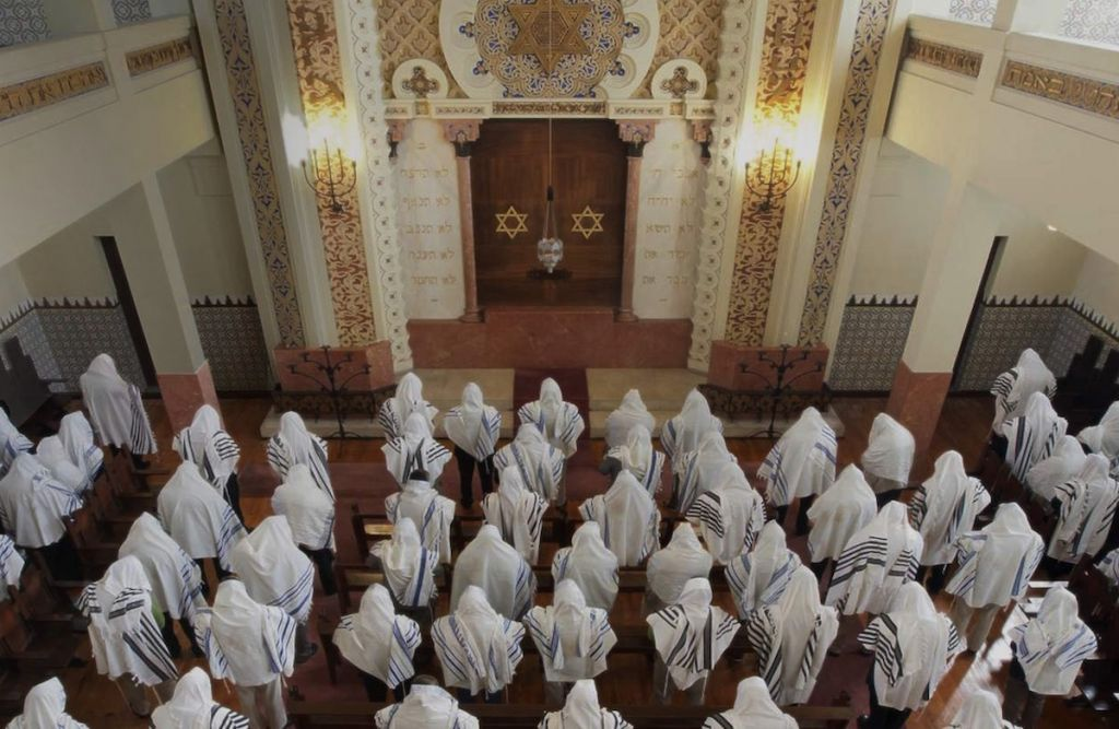 Congregants praying at the Kadoorie Synagogue in Porto, Portugal, May 2014. (Courtesy of the Jewish community of Porto/JTA)