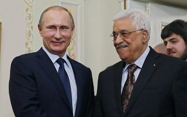 Russian President Vladimir Putin (L) shakes hands with his Palestinian counterpart Mahmoud Abbas during their meeting at the Novo-Ogaryovo residence outside Moscow on April 13, 2015. (Photo credit: AFP/ POOL / SERGEI ILNITSKY)