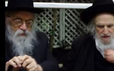 Rabbi Chaim Grenimann, left, and Rabbi Shmuel Auerbach at a meeting in Bnei Brak in 2012. (photo credit: YouTube screen capture)