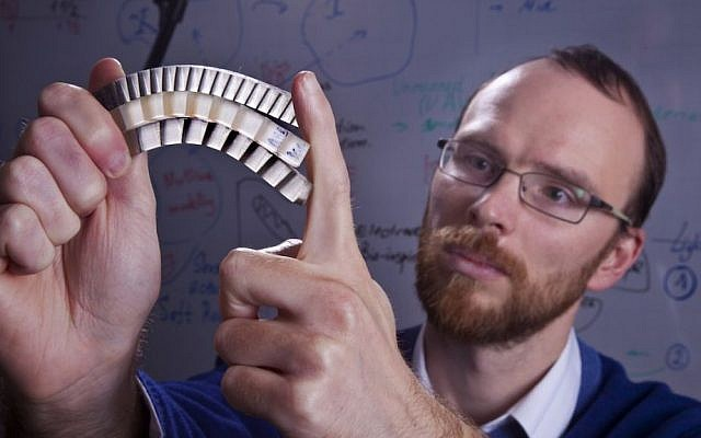 Assistant Professor Stephan Rudykh with a sample of the durable material (photo credit: Technion -- Israel Institute of Technology)